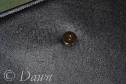 """""""female"""" side of the magnetic snap installed into the pleather pocket"""