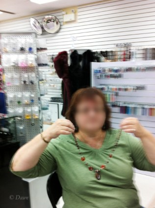 Class participant and her nearly-finished necklace (face blurred for privacy)