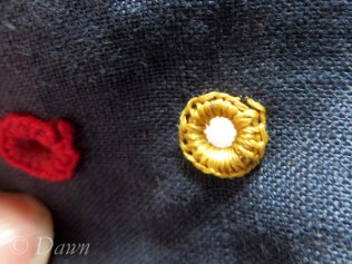 DMC eyelet and the brass eyelet covered in thread (before lacing test)