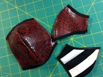 laced mask pieces bound and ready for lacing holes