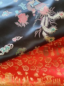 """Two """"Chinese brocades"""" - one has a phoenix pattern on black, and the other is red and gold with a 'travelling' pattern. - Grandmother's Fabric Sale 2017"""