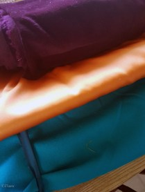 Burgundy cotton velveteen, an orange art-silk (synthetic) and teal art silk. All from the 2017 Grandmother's Fabric sale