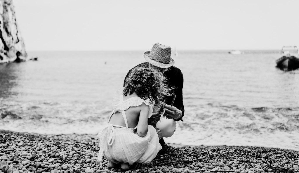 black and white image of father and daughter candid photo shoot