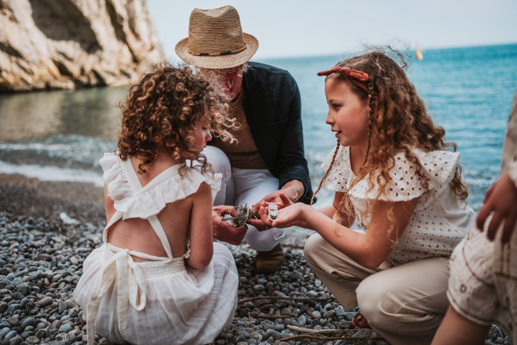 father with children family photography on beach