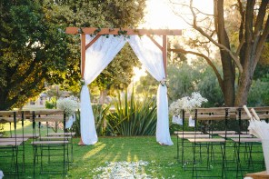 Wooden Arbor with lace curtains $150