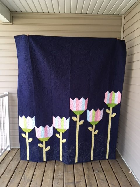 A modern twin sized tulip quilt