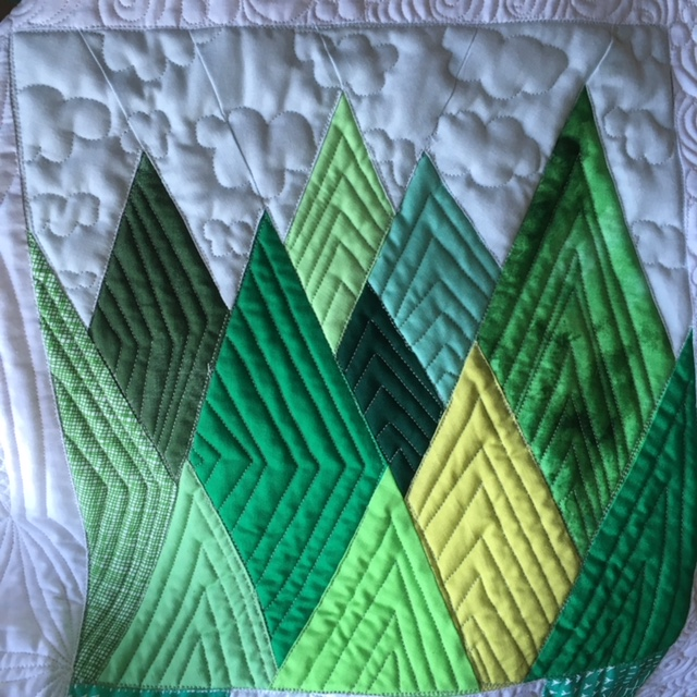 Coastal Majesty quilt block depicting British Columbia's majestic trees.