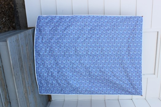Blue fabric on the back of the quilt.