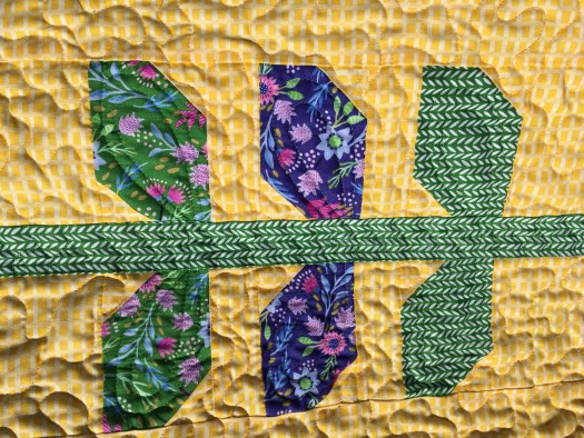 Machine quilting on the vines and leaves of the Garden Vines / Morning Glory quilt.