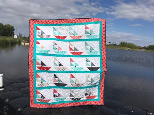 Sailboat quilt in Daysail fabrics pieced and quilted by Daydreams of Quilts.