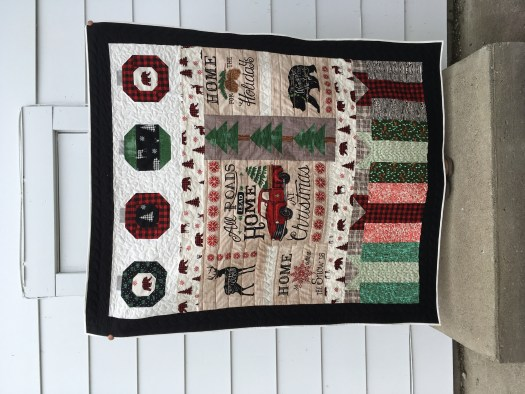 Holiday Lodge Christmas Throw quilt pieced and quilted by Daydreams of Quilts.