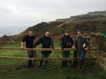 Chris, Jonny & volunteers posing with finished fence