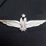 12 p.m. —Captain Rick Hansen, a pilot for American Airlines, wears his company's logo attached to wings on Tuesday, April 14, 2020. Captain Hansen is based out of Dallas International Airport and has to commute from Rapid City, S.D. for every trip.