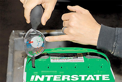 Testing a car's battery with a hydrometer