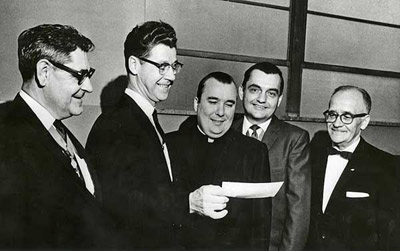 Father Murphy, center