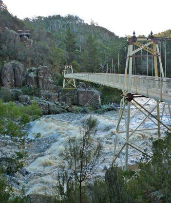 Bridge over a raging South Esk Rver