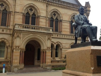 Beautiful portico. Statue is of Sir Walter Watson Hughes, on of the founders of Adelaide Uni