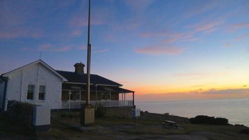 Sunrise behind the cloud colours the eastern horizon