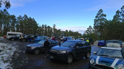 People in the upper carpark putting chains on their wheels