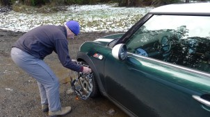 Stephen fitting chains to our MINI