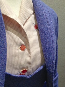 Joy McDonald - Close-up of pink stripe blouse detail & suit fabric