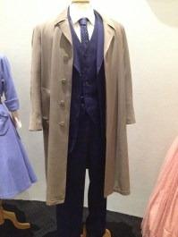 Dr [Lucien] Blake - 3 Piece blue wool suit, overcoat fawn 'Andrew Roberts', 'Phillips' white cottom shirt, black belt & 'Lavin' blue tie
