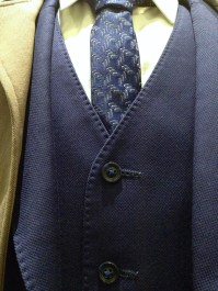 Dr [Lucien] Blake - Close-up showing details of tie and vest of blue suit