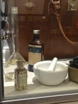 Pills, antiseptic, mortar & pestle, flask