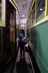 Elsie walking between trams