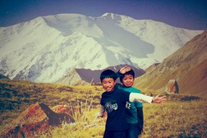 two boys with the Lenin Peak background