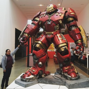 A woman having a fist bump with Hulk Buster