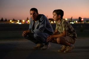 Christian Bale and Noah Jupe in Twentieth Century Fox's FORD V FERRARI.