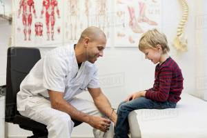 Man doctor taking care of sports injury
