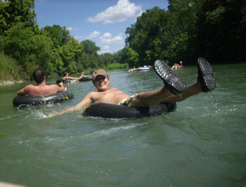enjoying a nice float down the river on an inner tube