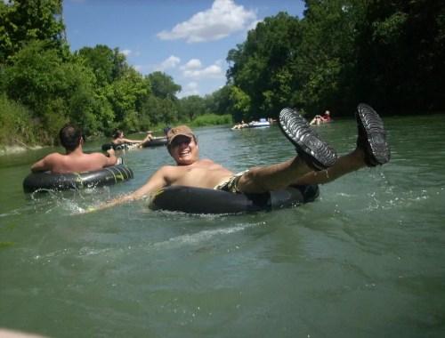 enjoying a nice float down the river on an inner tube