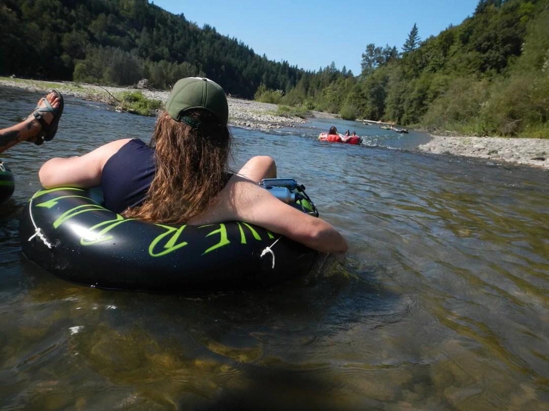 Enoying tubing down a river