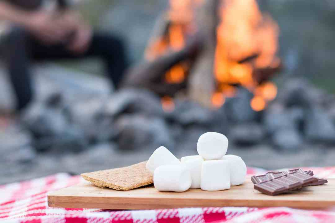 Preparing your perfect campfire smore.