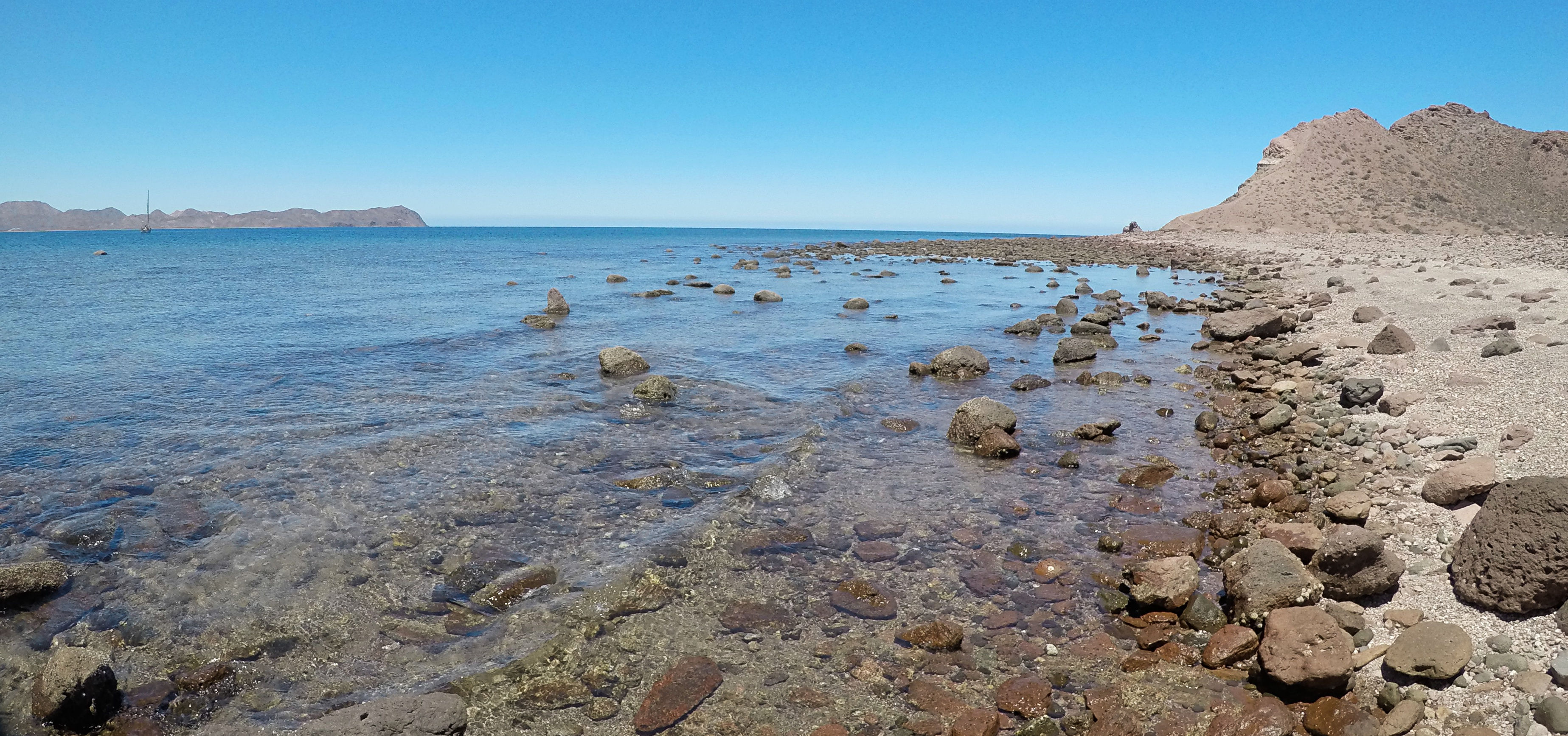 The rocky beach on the east side of the island.