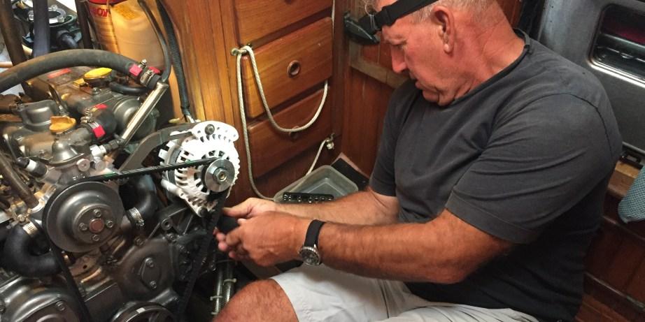 Captain Dan performing engine maintenance.