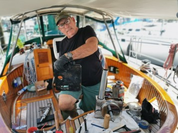 Captain Dan working on the windlass in the cockpit