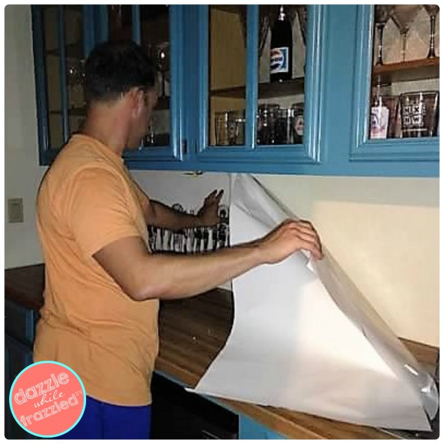 How to install large vintage graphic printed on re-positionable fabric graphic decal. DIY alternative to tile backsplash for wet bar.