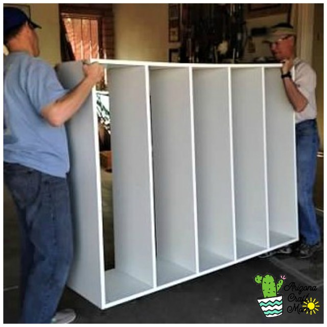 Use melamine boards to build DIY mudroom entryway storage cubby system for your family's stuff.