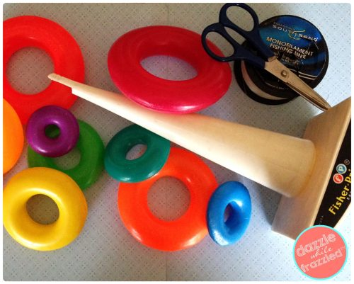 How to use a stacking ring toy to create a mobile | DazzleWhileFrazzled.com
