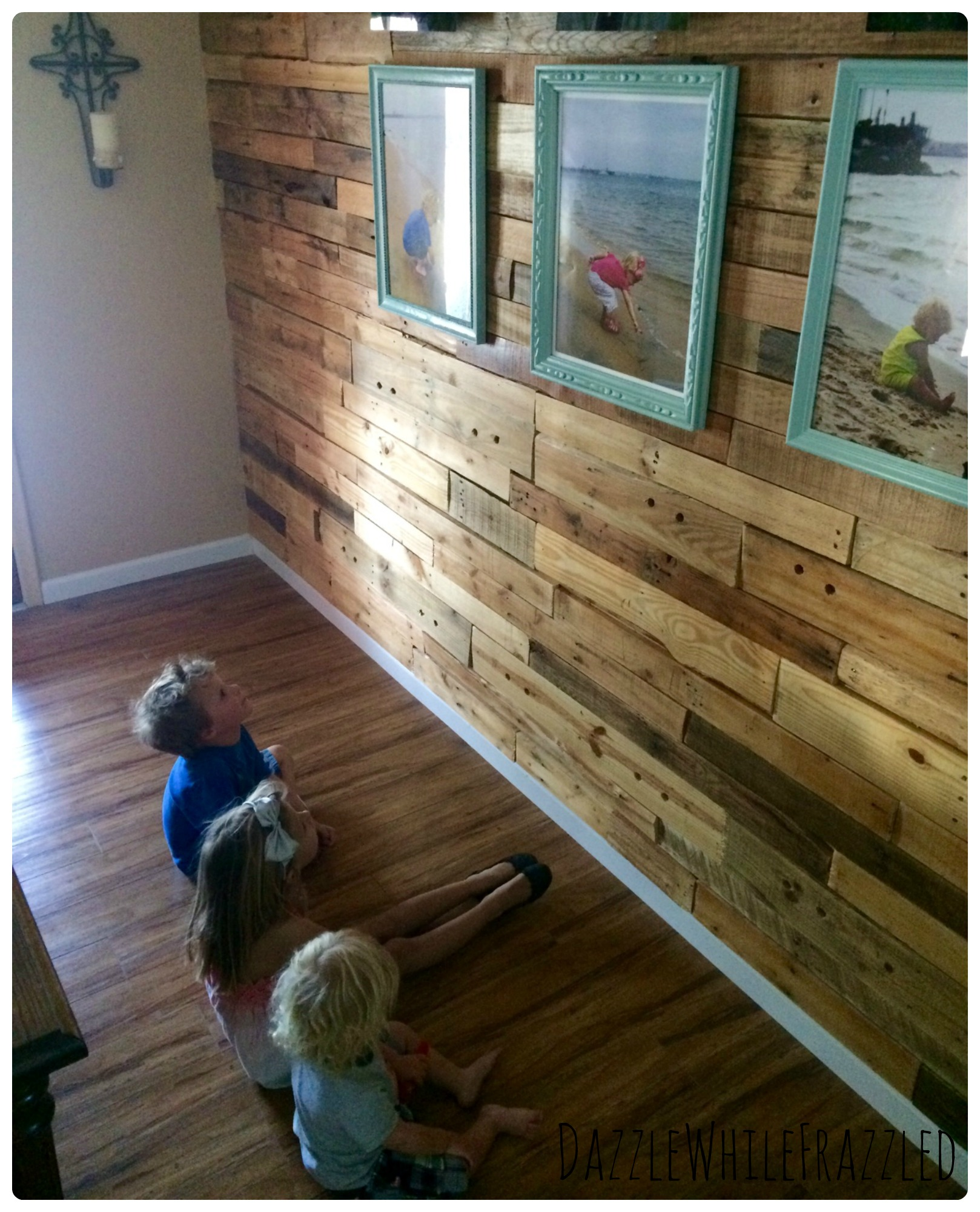 How To Decorate A Wood Pallet Wall With A Photo Display