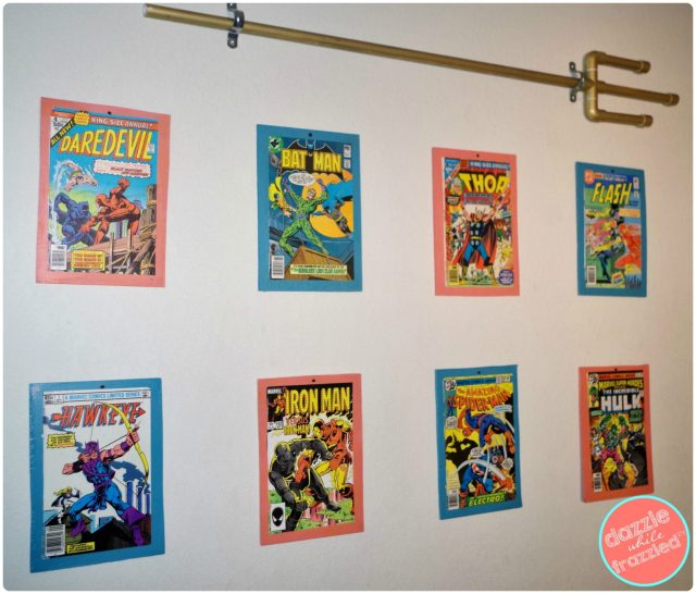 Make a simple superhero gallery wall using old comic books