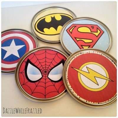 DIY superhero gallery wall using paint can lid superhero emblems | DazzleWhileFrazzled.com