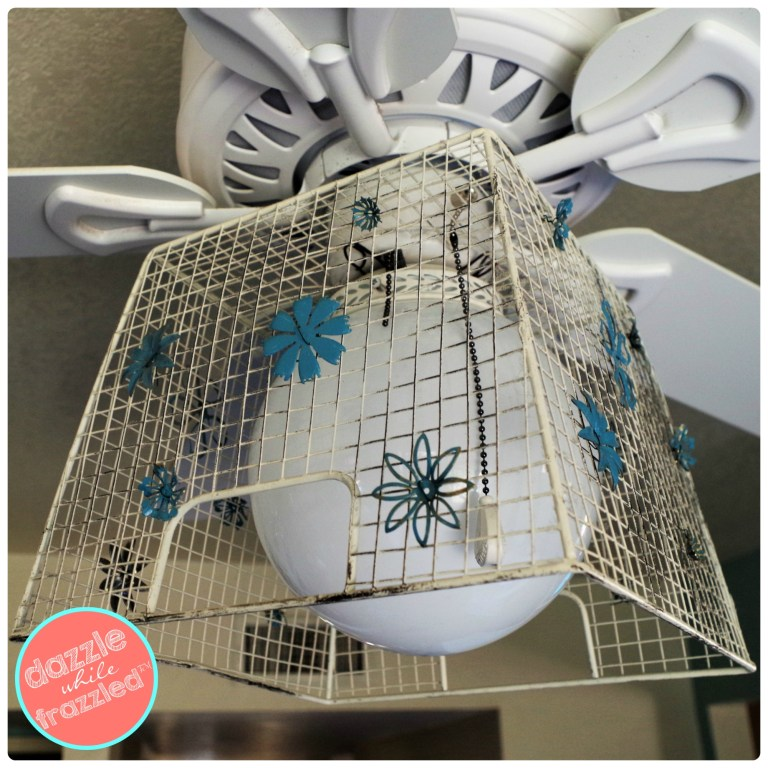 Use a metal wire basket and vintage metal flowers to update $68 builders ceiling fan