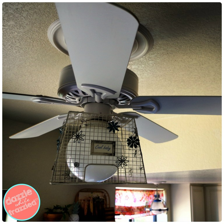 How to update a $68 white builders ceiling fan using metal farmhouse basket and vintage metal flowers