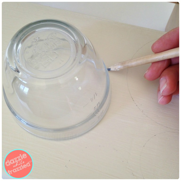 Use a round template to trace circles onto a kids step stool for DIY kids stool makeover with paint