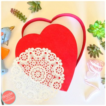 Use paper doilies, heart chocolate box, fake succulents and hot glue to make 10-minute DIY Valentine's Day heart wreath